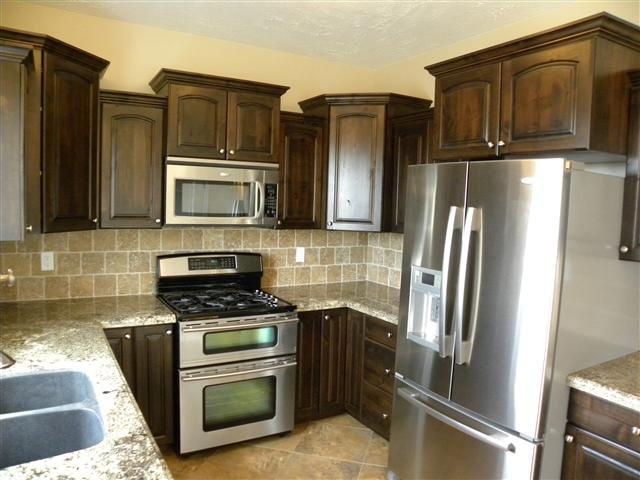 dark kitchen cabinets Stainless steel appliances  Home Ideas