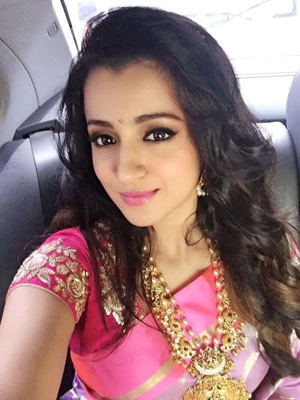 Trisha Krishnan taking a #selfie at an event. #Tollywood #Fashion #Style #Beauty #Hot #Saree #Desi