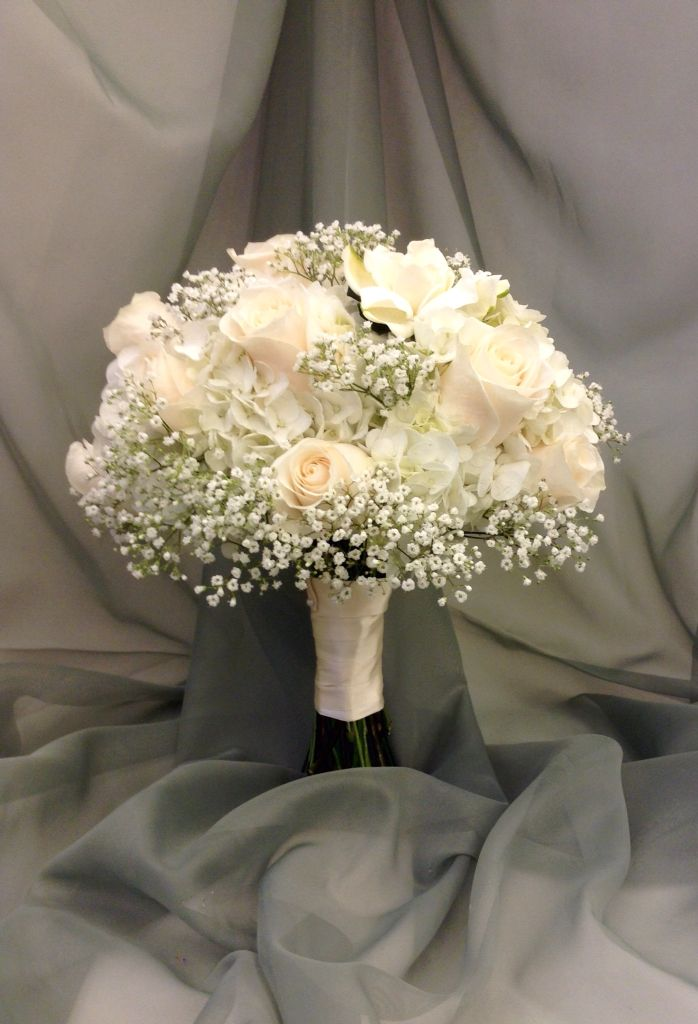 White bridal bouquet with hydrangea, roses, babies breath and gardenias by Nancy at Belton hyvee.
