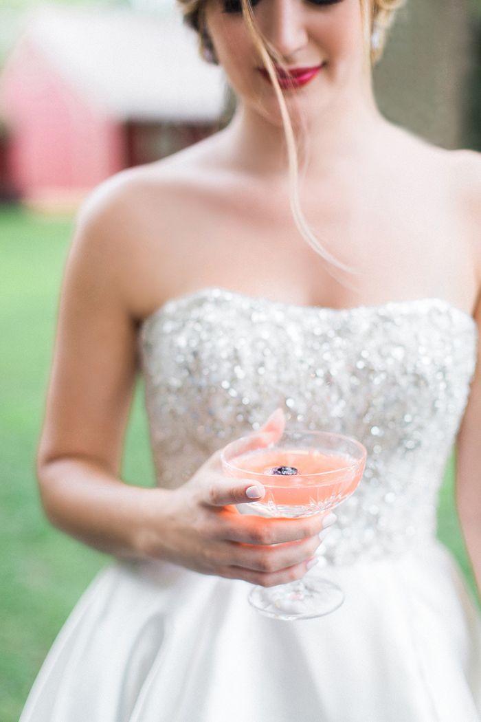 Peach Colored Cocktail with Edible Flowers for a Glam Summer Wedding    #AisleSociety #ad #ASforDB #DBMaids #DavidsBridal #OlegCassini #wedding #weddingday #weddingdress