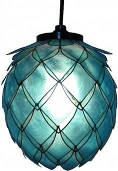 """This handmade Capiz shell hanging lotus lamp is designed in the shape of an opening lotus flower, with many layers of translucent capiz shell petals. The lamp measures 8"""" high and 9"""" in diameter. Shell edges and bases are black, giving the lamp a dramatic and clean contemporary look. We recommend using a 13 watt compact fluorescent (CFL) light bulb with this lamp. (This comes with an electric hard wire kit.)  Available at Pangea St. in Saxonburg, PA"""