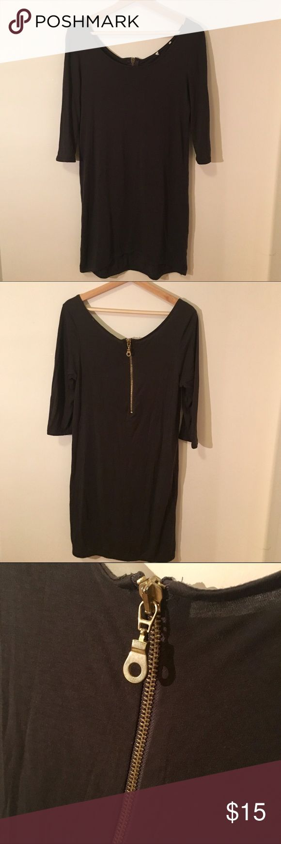 ZARA 3/4 sleeve zip back dress Essential Wardrobe piece! This dress was bought at Zara but tag was removed because it was itchy. Cotton, light-weight, black mini with 3/4 sleeves. Cool brass zipper detail in the back! Zara Dresses Mini