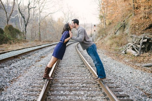 kisses over the railroad tracks, the most romantic engagement shoot, the most romantic love story, fall engagement session, Natalie Franke Photography