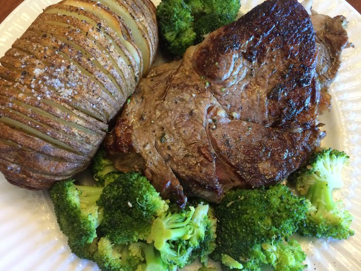 A HEARTY dinner: Fresh organic broccoli cooked stovetop with a cup of water, 2 cloves of fresh pressed organic garlic, a tbsp. of EVOO and some S&P. An organic russet potato sliced 3/4 of the way through, drizzled with EVOO and S&P then baked at 425 for 45 min. And an antibiotic/hormone free ribeye cooked stovetop with grass fed ghee, fresh rosemary, fresh thyme and a sprinkle of S&P.