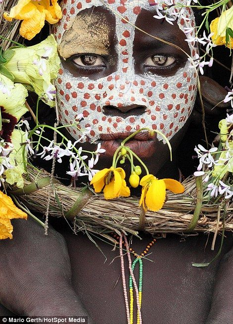 A child from the Surma tribe of Ethiopia wearing traditional face paint...