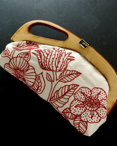 Yumiko Higuchi embroidered clutch. It's nice to see something functional being done with embroidery.