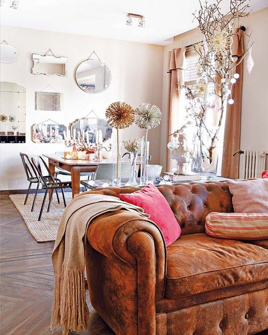 vintage mirrors and distressed chesterfield
