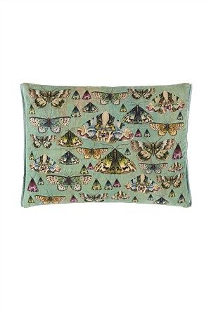 A luxurious velvet cushion from Designers Guild featuring exquisitely drawn butterfly specimens. Digitally printed in iridescent tones of jade, aqua and emerald green, reversing to a trio of butterflies on a textured background print in jade green.