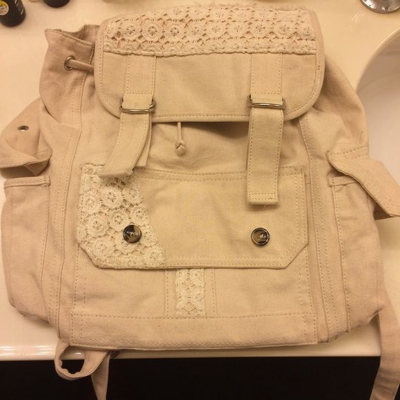 Cream lace backpack Cream backpack from tillys with lace detailing. A few discolorations, but not noticeable. Tilly's Bags Backpacks