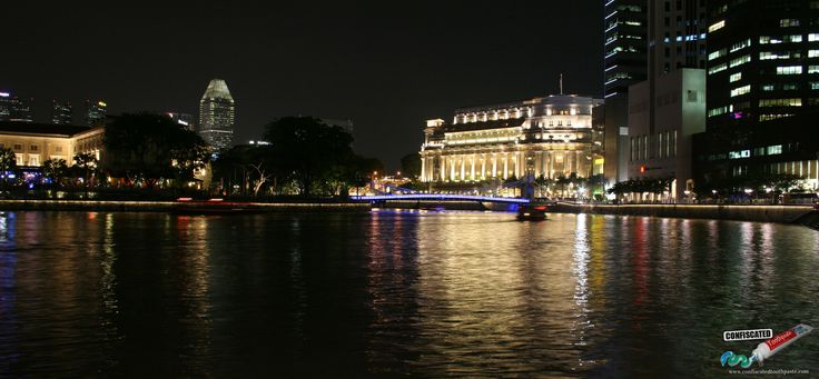 Fullerton Hotel and the Singapore River by night. 10 Cool Things to Do In Singapore ---> http://www.confiscatedtoothpaste.com/cool-things-to-do-in-singapore/