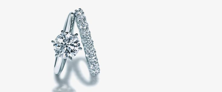 Tiffany Harmony® Round Brilliant Engagement Ring with Diamond Band in Platinum