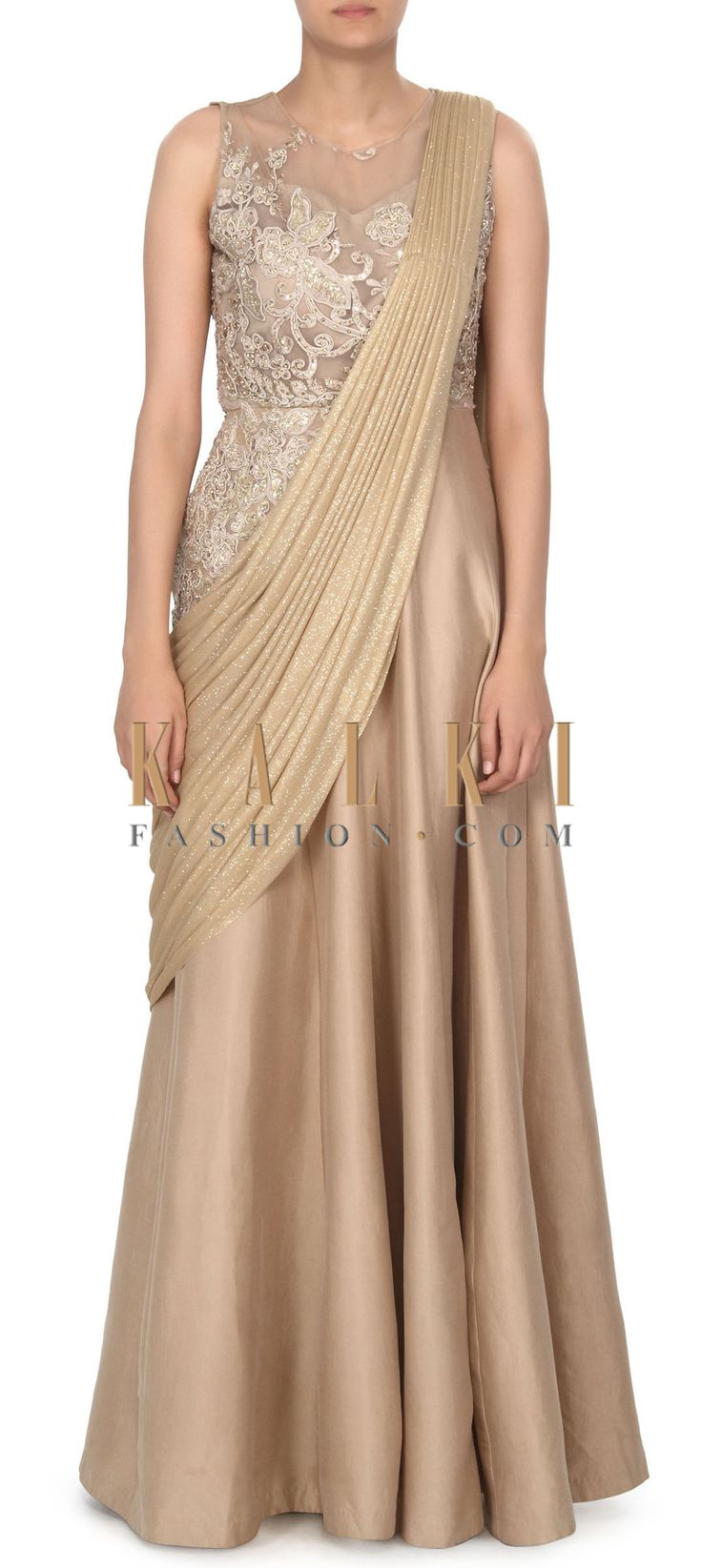 Buy this Beige saree gown adorn in floral and resham embroidery only on Kalki