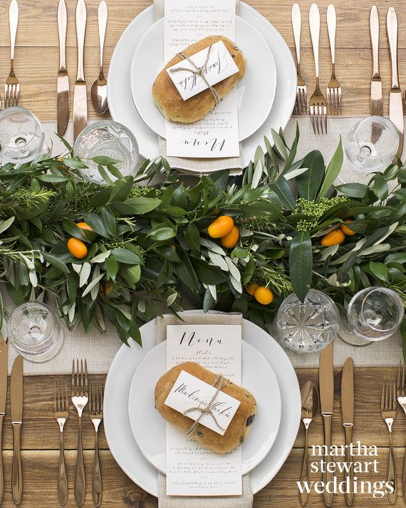 Mackenzie spent part of his childhood in Italy, and Louise loves family-style dining, so long, rustic tables—set with copper-colored flatware, flax linens, and garlands made from kumquats, olive, skimmia, rosemary, and ruscus—were a natural choice. Simple brown twine cinched place cards to mini loaves of focaccia with olive, rosemary, and feta.