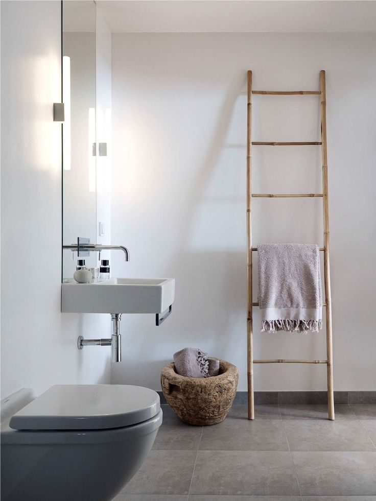 Latter for scarf collection : http://www.houzz.com/photos/12450316/8-Bamboo-Ladder-Rack-21W-x-96H-asian-towel-bars-and-hooks