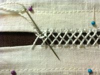 Embroidery joining together the two sides of a Cap of St Birgitta