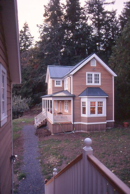 """Tim Andersen, Architect.  Orcas Island, Washington. This view of """"Garden House"""" is from stair to apartment above garage.  Buildings have lightly stained red cedar siding with Zincalume corrugated roofs."""