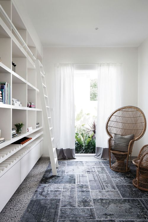 mmm storage with ladder & wine rack (and a clever way to cover ugly flooring -  a giant rug)