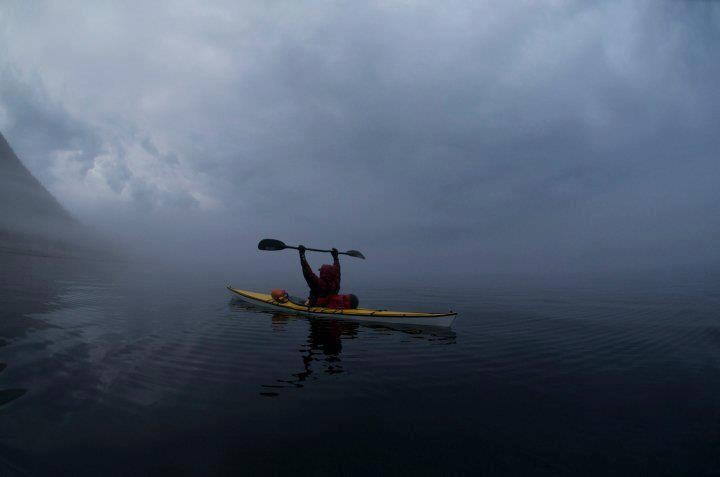 Kayaking into the fog in Manicouagan, Quebec (pinned by www.redwoodclassics.net).