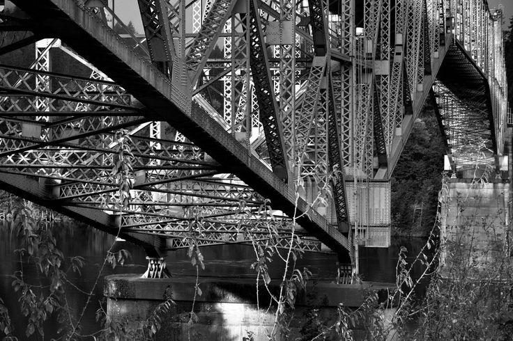 thor_mark  posted a photo:  A conversion to Black & White using Capture NX2. I found that brought out a much richer tonal contrast with the steel trusses of the bridge. I wanted to do with this image was take a capture looking across the metal framework of the bridge from the nearest view where it more of the underside and then off to a distant point looking across the bridge side.