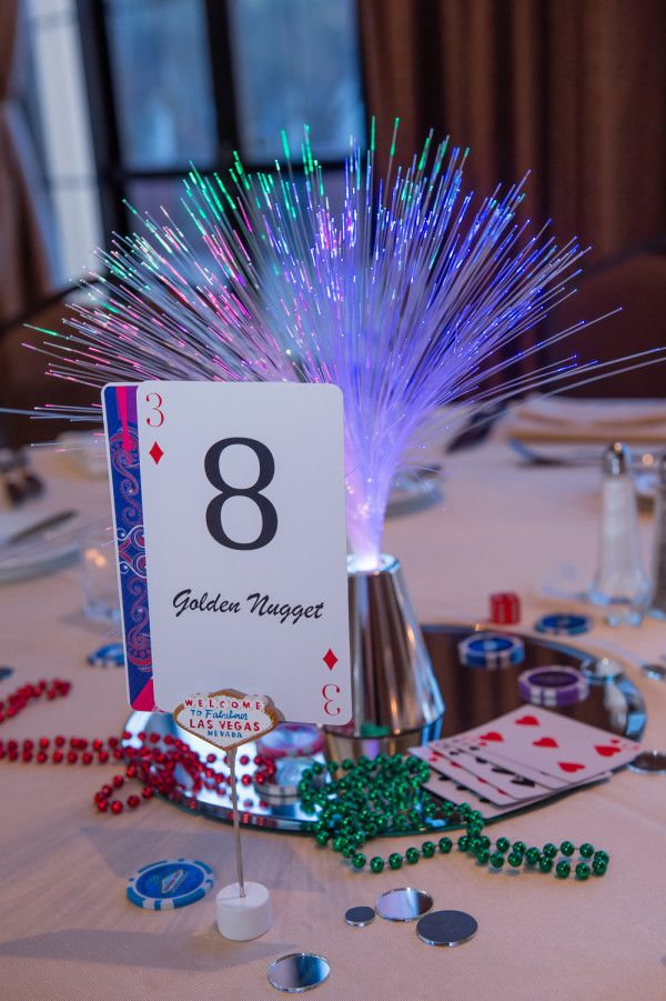 Glowy, sparkly centerpieces for a Vegas or casino wedding theme. Photo: Images by EDI