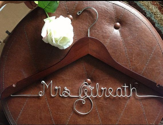 Such an adorable idea :) It would be a great gift from the Maid of Honor to the Bride to hang her wedding dress on!