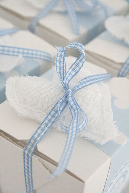 Gift wrapped with a strip of spotted paper, a little heart and checked ribbon♥