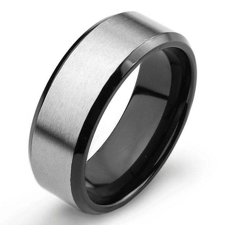 This sleek two-tone titanium men's ring features a brushed silver channel over highly polished black plating. Whether as a modern wedding band or accessory it is sure to complement any style.