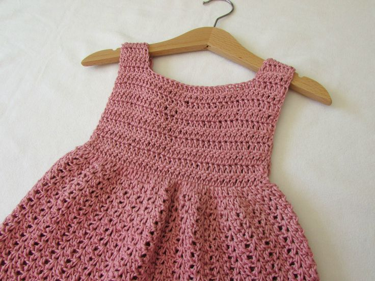 This tutorial will show you how to crochet a pretty dress which can be made in any size from baby to girl's to women's. This dress is suitable for beginners....