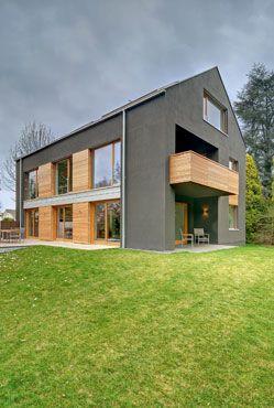 Die besten 25 hausfassade grau ideen auf pinterest for Moderner baustil einfamilienhaus