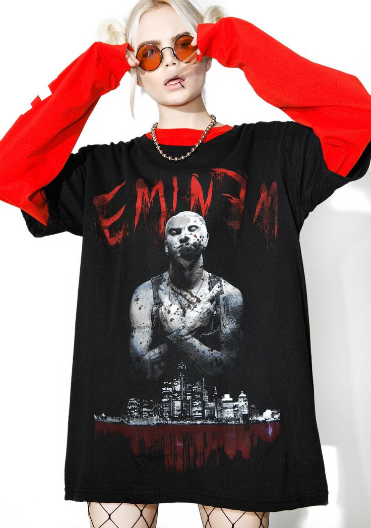 Bloody Horror Tee will show ya the tru meaning of fear… This sikk 'N cruel tee features a comfy black construction, oversized fit, and Eminem graphic across tha front with Detroit skyline.