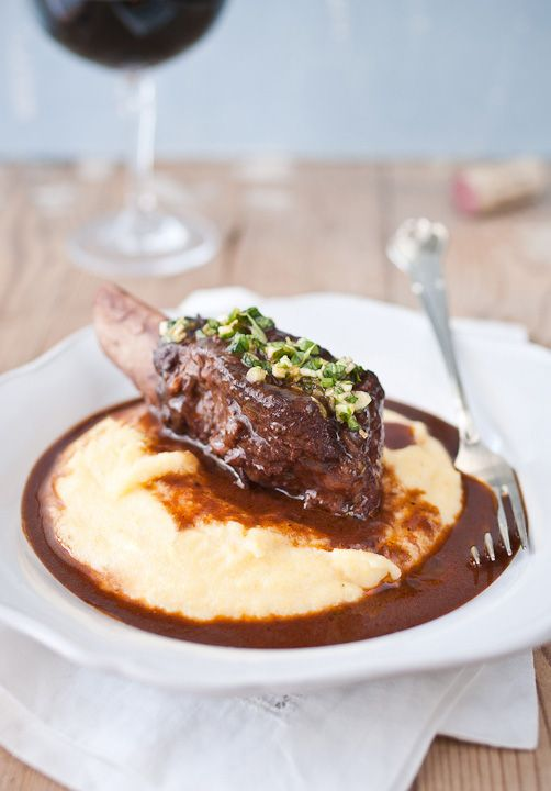 Red wine braised short ribs on a bed of creamy polenta... Definitely a man's meal, but YUM.