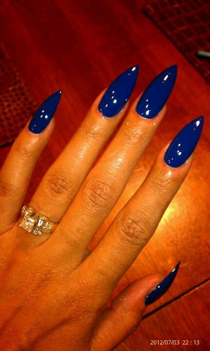 Stilleto nails..... Love the color, not so much the length