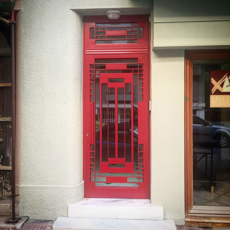 Iron red door, retro style, Mackintosh inspired, Listed 1930's building.