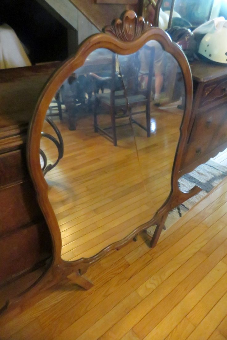 """Bentwood upholstered rocking chair, with cat pillow, measures 43""""x34""""Xx21"""", 4 drawer wood dresser w/ mirror (mirror is cracked) measures 46""""x24""""x 82"""", 4 drawer dresser w/ 3 part mirror, measures 19x41""""x 67"""", all are in fair to good condition."""