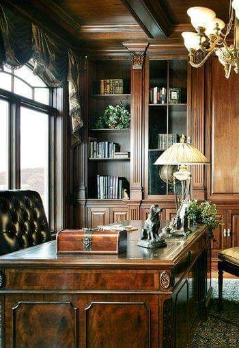 traditional office, burled wood desk with wood inlays, built in bookshelves. fluted pilasters with Corinthian capitals, coffered ceiling. balloon/ jabot window treatments. classical chandelier. tufted leather office chair. shop DesignNashville.com for lighting and draperies.