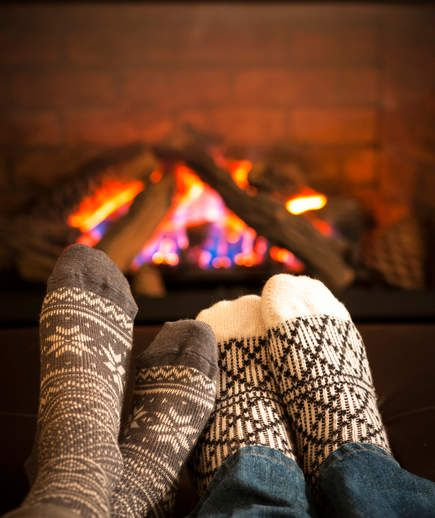 Two feet in front of fireplace | Everyone's favorite hard-to-pronounce Danish word has taken over more than just American culture.