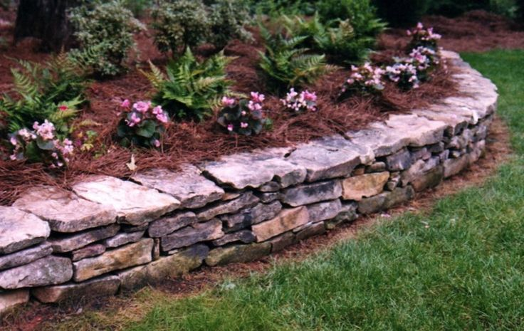 Low stone wall flower bed for the garden pinterest for Landscaping flower beds with stones