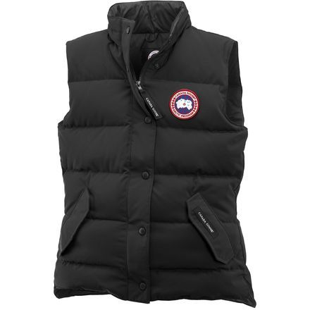 The Canada Goose Women's Freestyle Down Vest comes in quite handy when you camp, hike, ski, and backpack. Toss this 625-fill down vest on when the sun goes down and there's a chill in the air at your campsite, or simply stuff under your head and use as your pillow when you sleep in your tent. Instead of buying a new jacket this spring, just pull on the Freestyle when you go slush skiing and show off your mad pond-skimming skills. Its hip length and longer back-cut protect you from the cold…