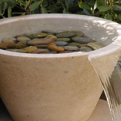 I'm not generally big on water fixtures or yard art, but this fountain is very lovely and natural looking. I could really like this.