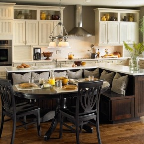 I grew up with a kitchen booth..love THIS one!!!booth seating attached to an island