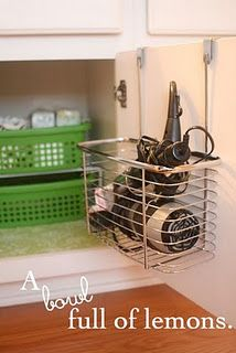 Love this idea.  This is how I store my curling irons and blow dryer, except mine sits over the edge of my toilet between the sink and toilet.  Its just a basket made for extra toilet paper rolls!