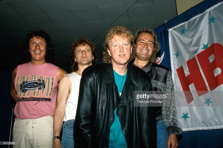 Musician Mick Jones (R) and other members of rock group Foreigner.