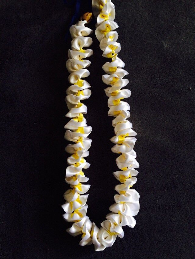 A personal favorite from my Etsy shop https://www.etsy.com/listing/228242098/hawaiian-plumeria-ribbon-lei-graduation