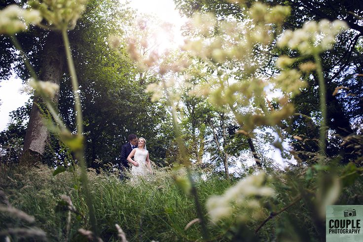 The newlyweds surrounded by greenery in the gorgeous grounds of Tulfarris. Weddings at Tulfarris Hotel & Golf Resort photographed by Couple Photography.