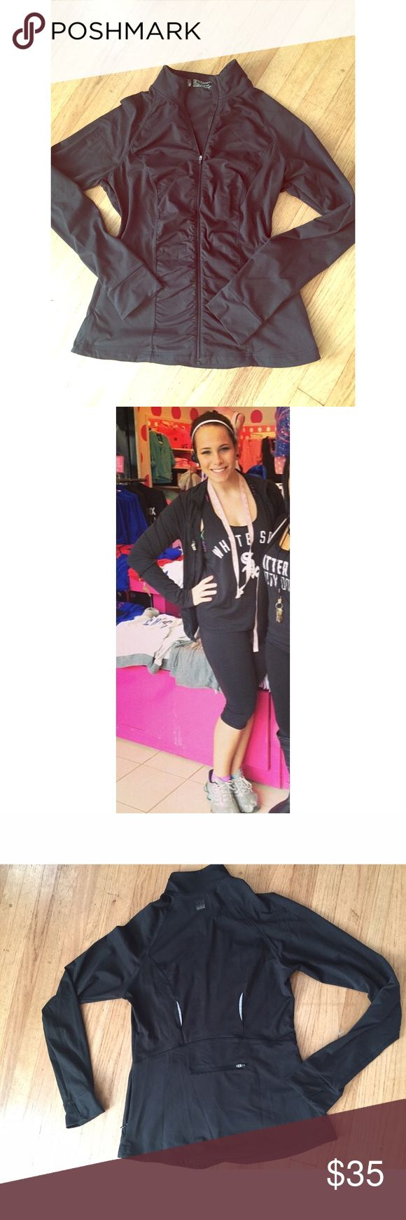 Victoria's Secret VSX Sport Jacket Classic black Victoria's Secret VSX sport jacket! Super functional bodywick material, perfect for sweat resistant training and keeping cool OR warm! Super flattering ruching down the center of the jacket and pockets with zippers, as well as a zipper on the back. Reflective detailing on the back... AND thumb holes! Who doesn't love thumb holes?! Has been previously loved, but still fully functional and in good condition! Perfect for every day use, whether or…
