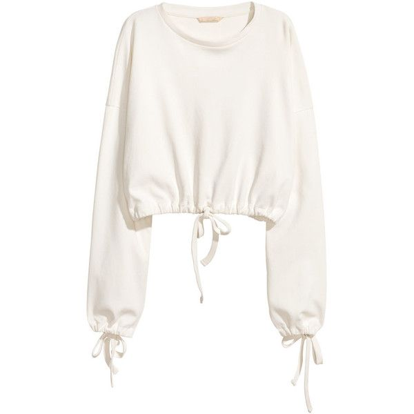Light pink. Short, wide-cut sweatshirt in cotton with dropped shoulders. Long, wide sleeves with drawstring at cuffs. Ribbing at neckline and a drawstring