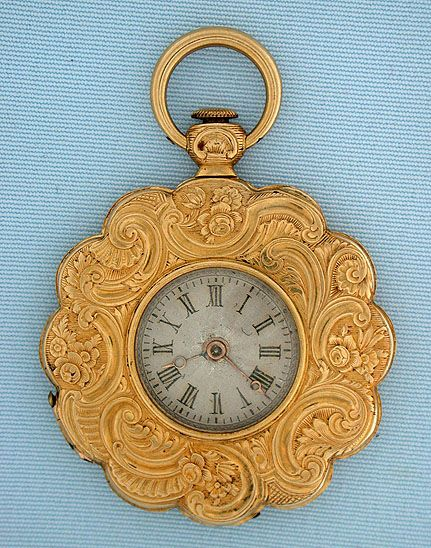 Lovely Swiss flower form ladies antique pendant watch by Freundler, Geneva, circa 1830. The case chased and engraved overall with scrolling floral foliage. Silver dial with black numerals and gold Breguet hands. Gilt keywind 6 jewel cylinder movement.