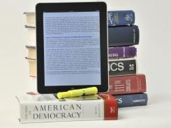 Some universities require students to use e-textbooks / Yasmeen Abutaleb @usatodaycollege | Students don't seem to want to buy e-textbooks. So some schools are simply forcing them [...] | #digitalearning