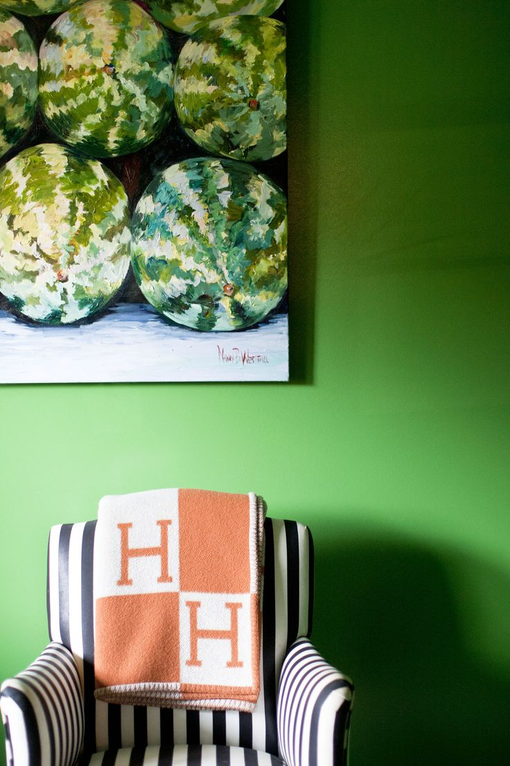 Great looking emerald green wall...black & white stripes...Hermes throw, & THAT painting!