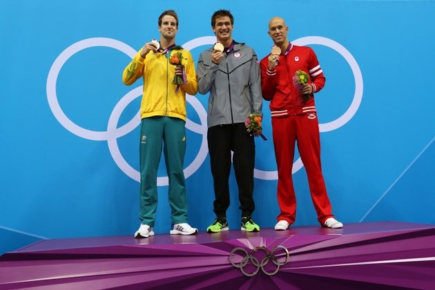 AUGUST 01: (L-R) Silver medalist James Magnussen of Australia, gold medalist Nathan Adrian of the United States and Brent Hayden of Canada celebrate with their medals on the podium during the medal cermony for the Men's 100m Freestyle on Day 5 of the London 2012 Olympic Games at the Aquatics Centre on August 1, 2012 in London, England. (Photo by Clive Rose/Getty Images)